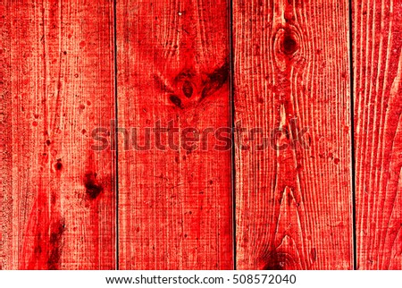 vertical vintage red coral old wooden planks with cracked color paint texture, wooden planks with scratch and cracked paint as background, high quality resolution