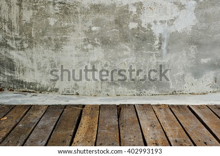 Vertical wooden planking floor and gray concrete wall. Display for objects.