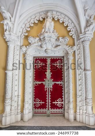 Very ancient castle door facade Regaleira. Beautiful frescoes history. - stock photo