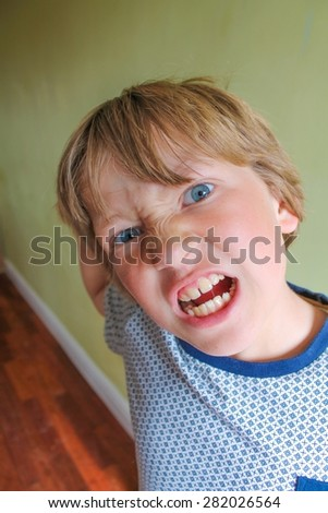 Very angry child having a temper tantrum - stock photo