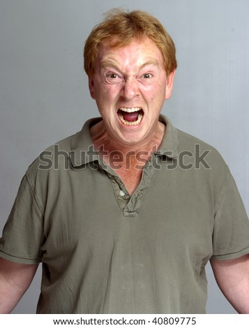 Very annoyed man shouting against a neutral background - stock photo