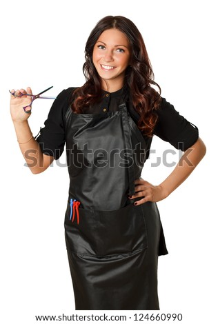 Very attractive and stylish professional hairdresser woman with scissors in right hand. With curly hair cut. In professional outfit. Isolated on white.
