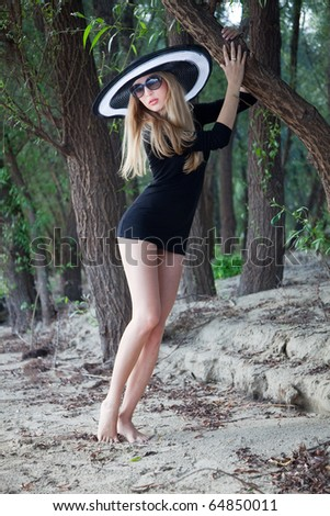 Very attractive girl with hat on the nature;
