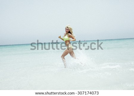 Very attractive women. shot in beach near pool. white skin. breast. beautiful smile. swimming dress. sunglasses. Lingerie. Nice ass. long legs. athletic body.
