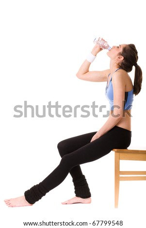 very attractive, young and fit woman drinks mineral water after some exercise, studio shoot isolated on white - stock photo