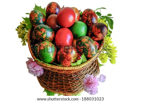 Very beautiful and colorful eggs inside a basket with mirror floor.