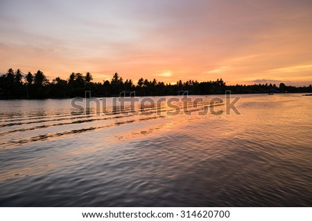 very beautiful and colorful sunrise over the river - stock photo