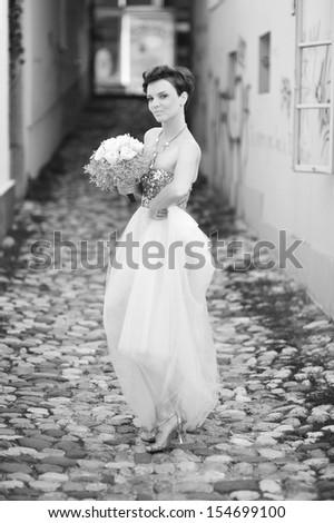 Very beautiful brunette in a wedding dress. Retro style  - stock photo