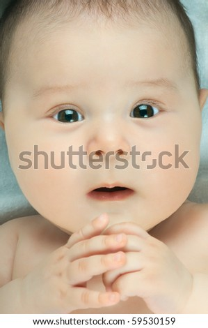 very beautiful  little kid ,  stare to lens, very closeup face - stock photo