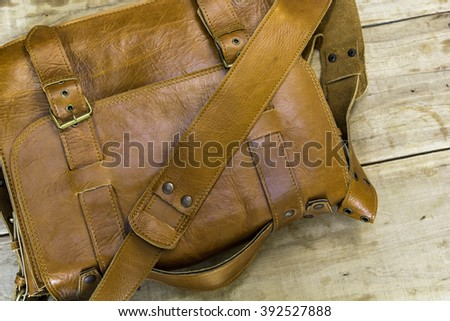 Very beautiful new leather bag on wood table