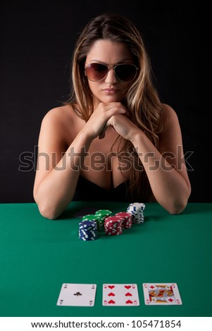 Very beautiful woman playing texas hold'em poker - stock photo