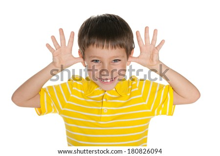 Very cheerful boy is hamming against the white background - stock photo