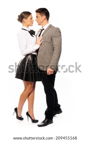 Very Close Middle Age Couple in Nice Fashion, Looking Each Other, Isolated White Background - stock photo