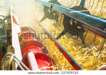 very close up combine harvesting wheat - stock photo