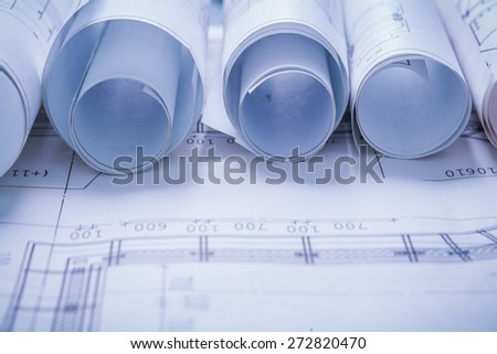 very close up view on rolled blueprints  - stock photo