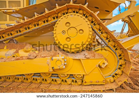 very close up view on the track of bbulldozer on sand - stock photo