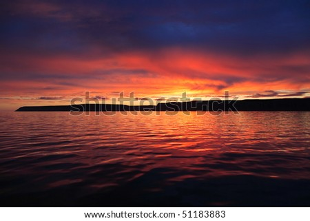 Very colorful sunset in Nunavut (high arctic) - stock photo