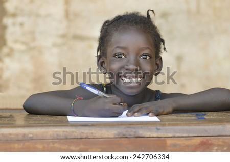 Very Cute African School Girl Toothy Smile in Bamako, Mali - stock photo