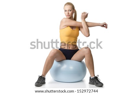 very cute blond girl in fitness pose sitting on big ball isolated on white. NATURAL SKIN - stock photo