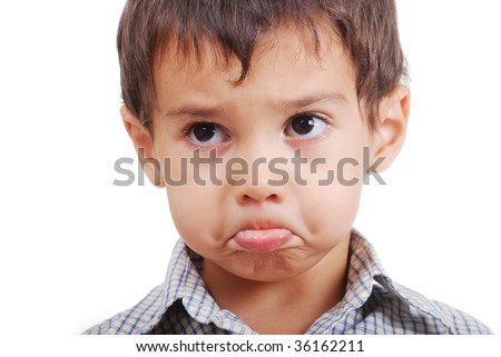 Very cute little boy with angry confused expression on face - stock photo