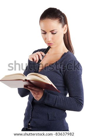 very cute young college student in casual dress reading a book