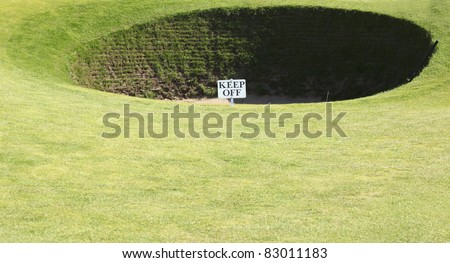 Very deep bunker at the old course of St. Andrews in Scotland - stock photo