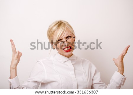 very emotional businesswoman in glasses, blond hair on white background. teacher hends up