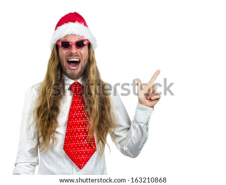 Very excited retro man in Santa hat pointing up at copy-space, isolated on white background - stock photo