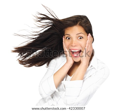 Very excited woman holding her head being surprised and looking at the camera. Mixed race caucasian / asian woman model. Isolated on white background. - stock photo