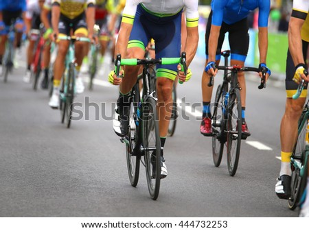 very fast cyclists pedal quickly through the streets of the city during the sporting event in europe