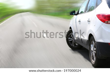 Very fast driving car on road