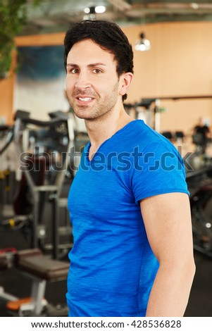 Very fit rainer man at the gym