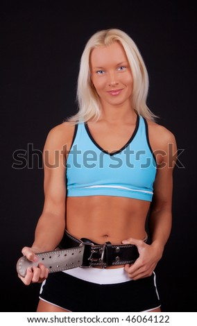 Very fit woman before  training - stock photo