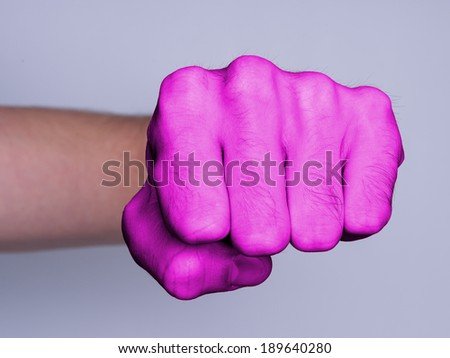 Very hairy knuckles from the fist of a man punching, pink skin - stock photo