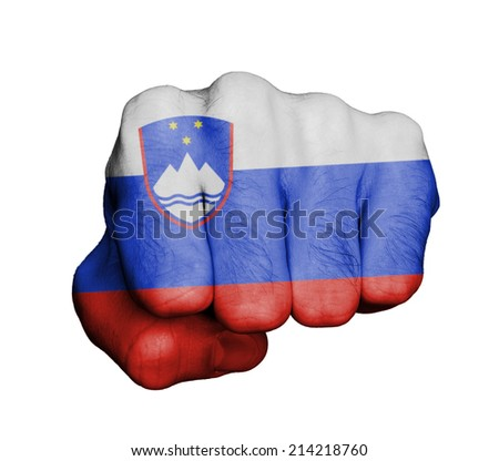 Very hairy knuckles from the fist of a man punching, with Slovenian flag. - stock photo