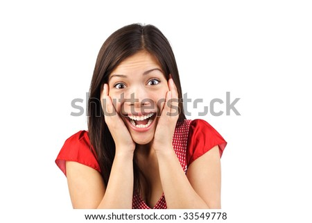 Very happy and surprised eurasian woman holding her head in amazement. Isolated on white background.