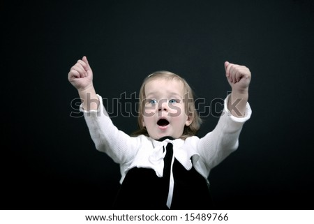 Very happy baby girl with arms raised, isolated - stock photo