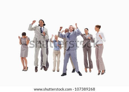 Very happy business people jumping against white background - stock photo