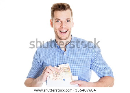 Very happy businessman holding money in envelope over white background - stock photo