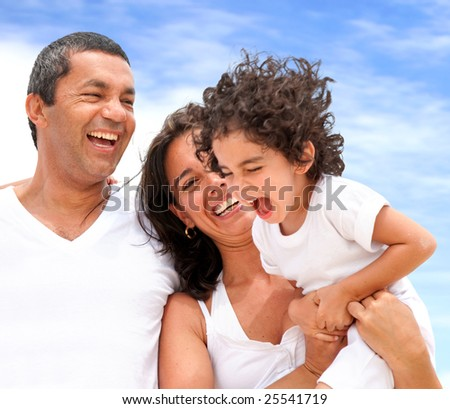 Very happy family on vacations laughing - stock photo
