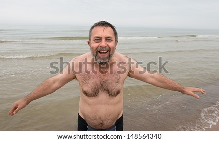 Very happy middle-aged man on the beach
