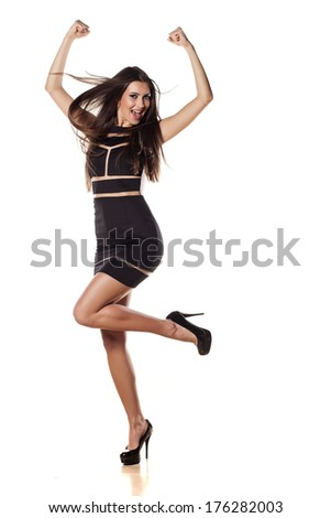 very happy pretty young woman jumping on white background