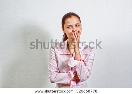 Very Happy Young Adult Female Wearing Pink Blouse Gesturing, Covering Her Mouth While Smiling