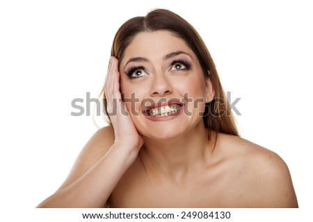 very happy young woman looking up on a white background