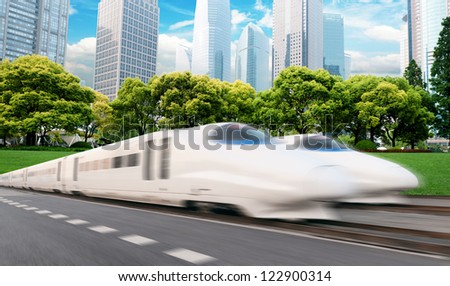 very high-speed train go through the shanghai financial center . - stock photo
