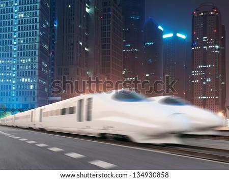 very high-speed train go through the shanghai financial center - stock photo