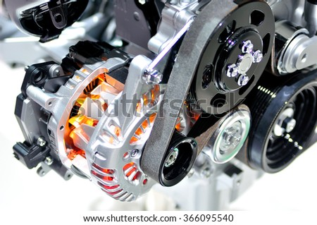 Very hot car alternator with drive belt. - stock photo