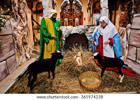Very large christmas nativity crib. Jesus in the manger. Holy family - stock photo