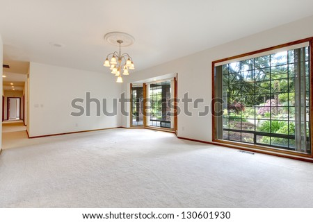 Very large empty living room with  sliding doors to the back yard. - stock photo
