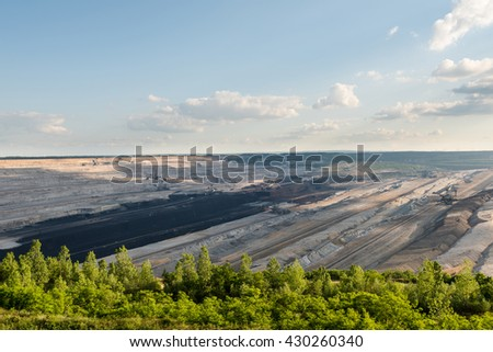 Very large excavators at work in one of the world's largest lignite (brown coal) mines in Hambach, Ruhr Area in Germany - stock photo